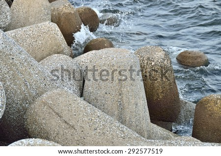 Concrete tetrapods at the sea coast #292577519