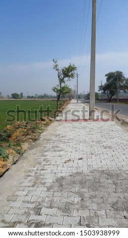 concrete tile way having electric poles in the mid