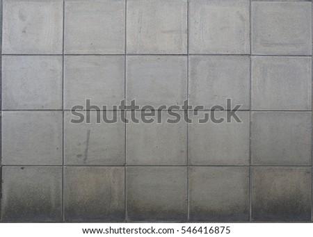 concrete tiled pavement background on the public pave way