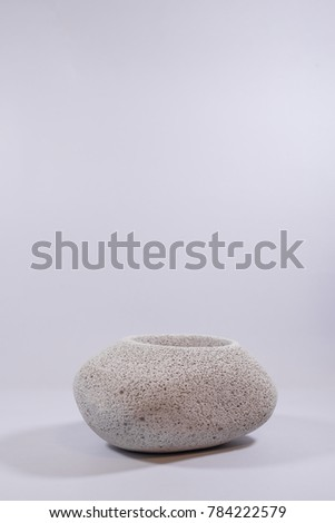 Concrete vase shaped stone on isolated white background #784222579