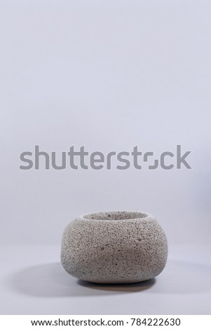 Concrete vase sphere on isolated white background #784222630