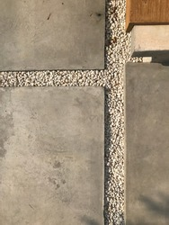Concrete walkway, pavement, floor, passage, path, footpath, pathway or passageway with small stone for walking along and connecting different section of a building, park or garden.