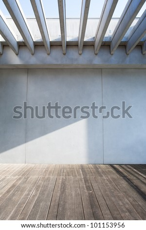 concrete wall and wood deck