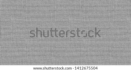 Concrete wall decoration texture, background. The pavement of granite stone. any paved area or surface. Old cobblestone road pavement texture, grass between stones