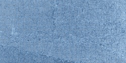 Concrete wall in a blue square matrix. A concrete wall with cracks and dents in the form of a blue matrix of small squares. For example, apply a blue matrix filter to the whole image. Texture, backgro