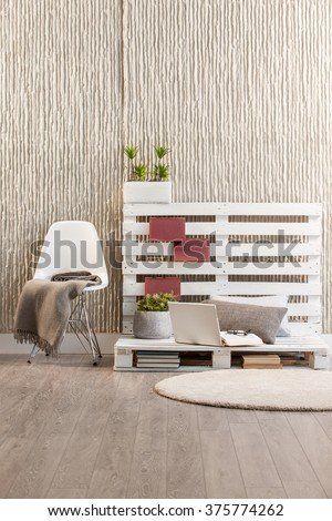 concrete wall interior handmade trendy decor with modern white chair laptop and round rug