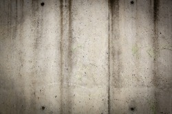 Concrete wall texture in rough, grunge style with stains and wear