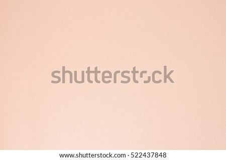 Concrete wall texture with deep peach solid color background.