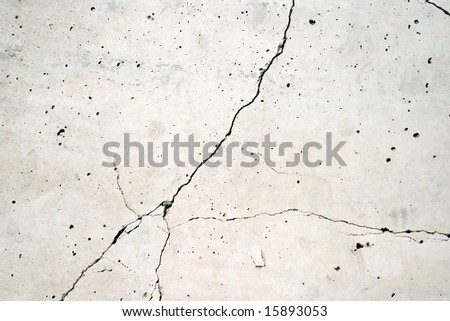 Concrete wall with a crack on middle, excellent as a background.