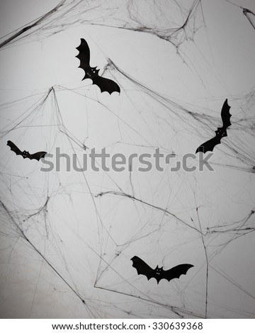 Concrete wall with cobweb and bat decorations. - Halloween background