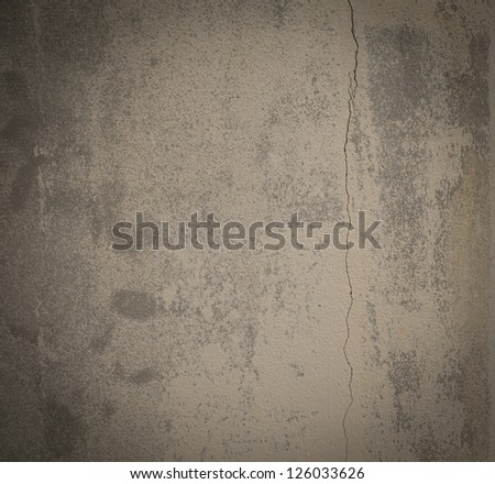 Concrete wall with cracks .