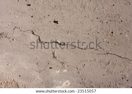 Concrete wall with cracks. Great for texturing.