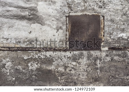 concrete wall with metal plate