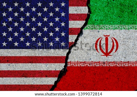 concrete wall with painted united states and iran flags #1399072814