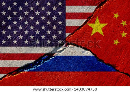 concrete wall with painted united states, china and russia flags #1403094758