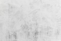 Concrete wall with whitewash layer, background photo texture