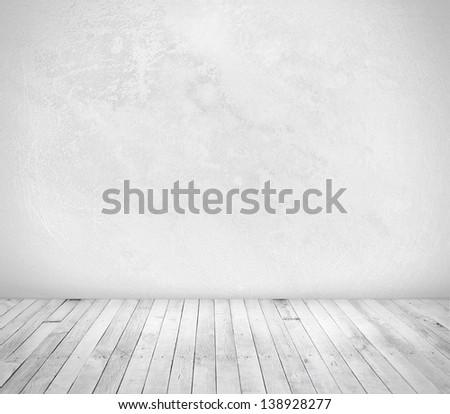 concrete wall, wood floor