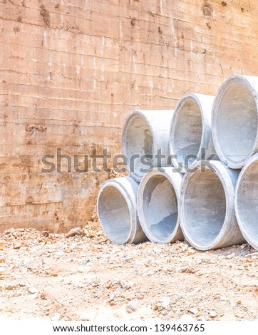 Concrete water pipes stacked in rows