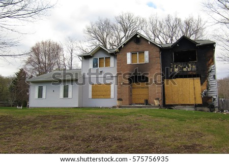 Condemned house, boarded up after a house fire.