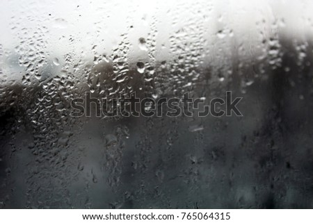 Condensation background with dew drops on glass window, humidity, foggy weather blank background, Grunge Abstract background with ancient ornament, outside the window winter, rain, autumn
