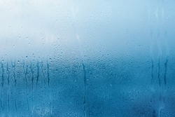 Condensation on the clear glass window. Water drops. Rain. Abstract background texture