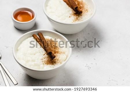 Condensed milk  rice pudding in bowls. Space for text. Stock photo ©
