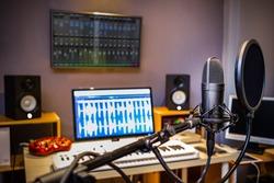 condenser microphone in digital recording, editing, broadcasting, podcast or online radio studio