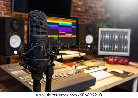 condenser microphone in digital sound editing & recording studio