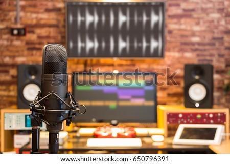 condenser microphone on digital recording studio background #650796391