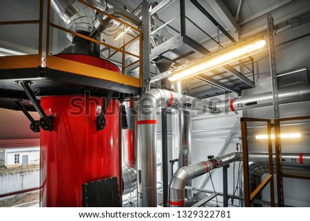 condensing economizer with fuel supply system pipes for solid-state chip boiler