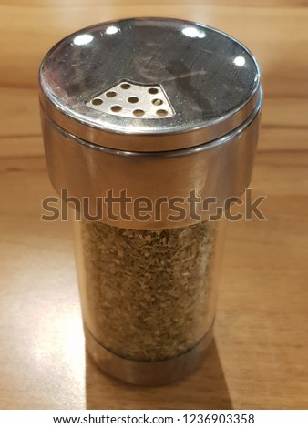 Condiment bottle is clear glass.  #1236903358