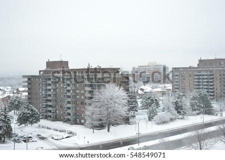 condo buildings in snow in...