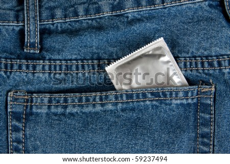 Condom in the pocket of a blue jeans
