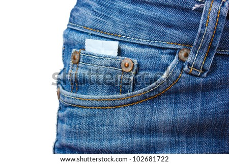 Condom in the pocket of blue jeans on white
