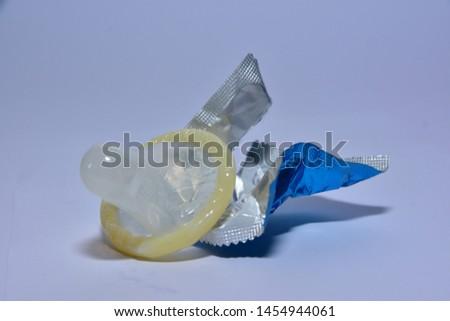 Condom maul white background and shiny