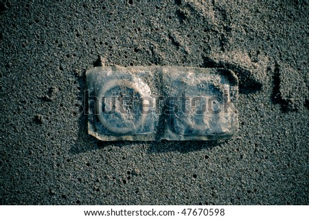 Condoms in sand
