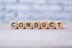 Conduct word written on wood block