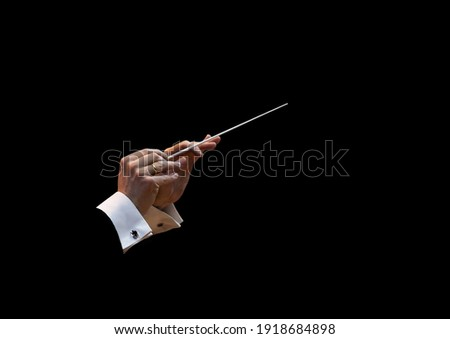 Conductor's hands on a black background Foto stock ©