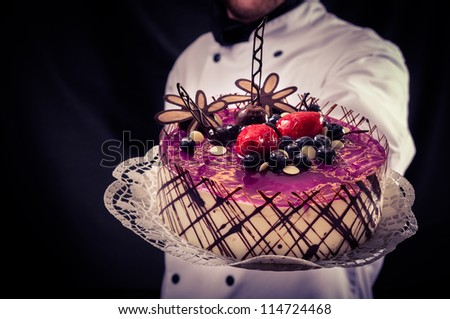 Confectioner and a beautiful cake