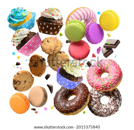 Confectionery and sweets collage. Donuts, cupcakes, cookies, macarons flying over white background.