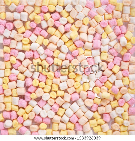 Confectionery. various color of confectionery including marshmallow and fruity jellies with soft focus.