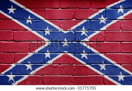 Confederate flag painted on grungy brick wall - stock photo