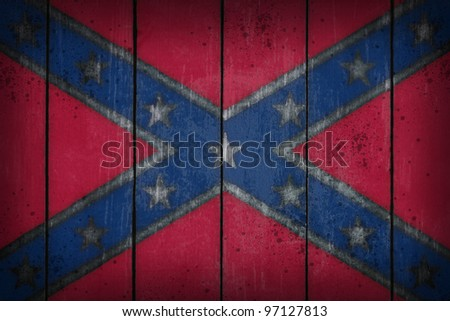 Confederate National Flag on old wooden wound - stock photo