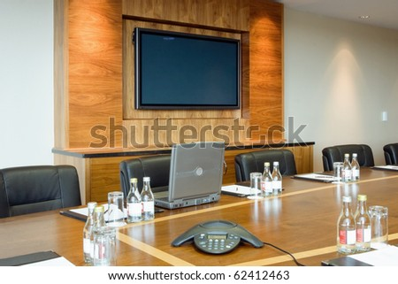 conference hall Interior with laptop on the table and big screen  on the wall
