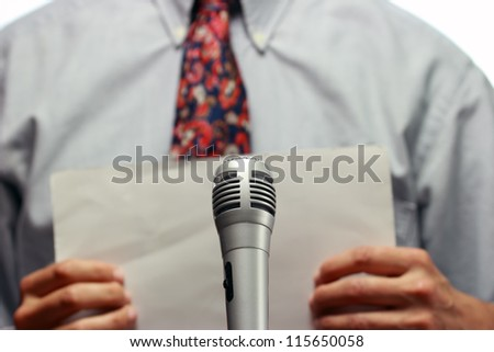 Conference meeting microphone and out of focus businessman