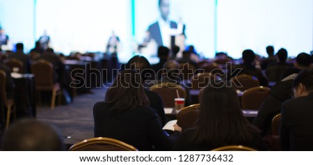 Conference Meeting Seminar Where Audience Listens to Lecturer for Training. Corporate Manager Speaker Gives Business Technology and Forecast. Group of People Hear Presenter Give Speech.