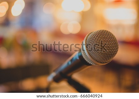 Conference microphone for meetings by Bokeh background. #666040924