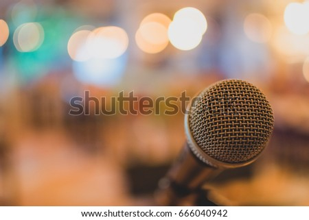 Conference microphone for meetings by Bokeh background. #666040942
