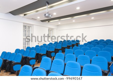 Conference room - typical empty conference room with chairs and LCD projector