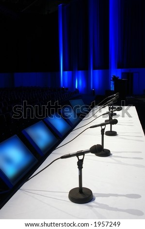conference room with microphones on the table